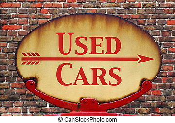 Retro sign Used cars - A rusty old retro arrow sign with the...