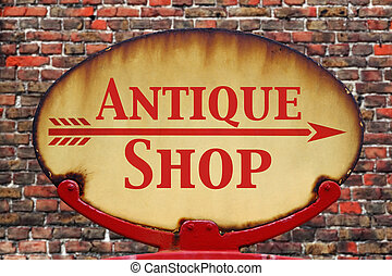 Retro sign Antique shop - A rusty old retro arrow sign with...