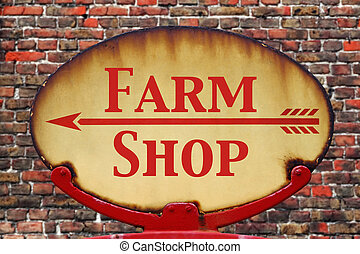 Retro sign Farm shop - A rusty old retro arrow sign with the...