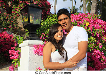Young couple in front of Bougainvillea garden