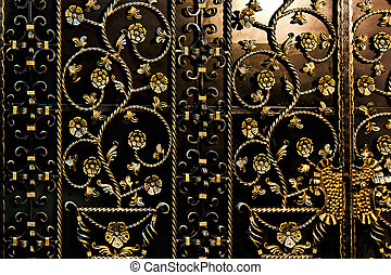 Ironwork black fence with golden floral decor