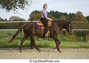 riding - beautiful cowgirl with horse