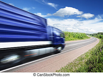 truck speeding on country highway, motion blur - blue truck...