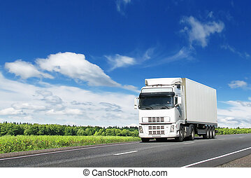 white truck on country highway under blue sky