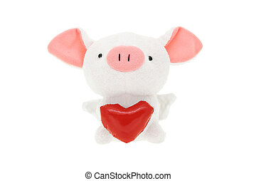 Piggy soft toy with red heart on white background