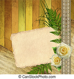Old paper card with flower and lace on wooden background
