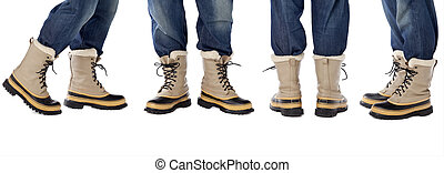 blue jeans and snow boots - man legs in blue jeans and heavy...
