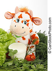 Cow with milk and greenery.