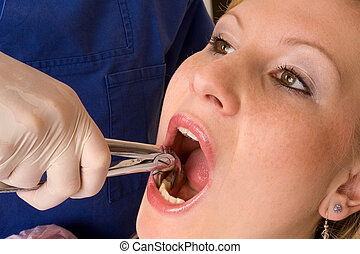 dentist - patient gets a treatment at the dentist practice