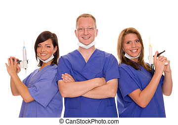 dentist with two dental assistants