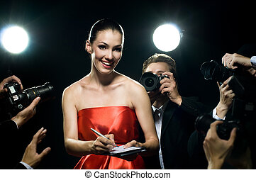 paparazzi - Photographers are taking a picture of a film...