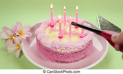 Lighting Birthday Candles - Lighting the pink candles on the...