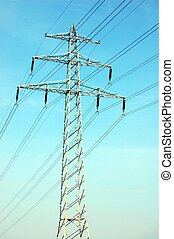 electrical tower and lines on background of blue sky...