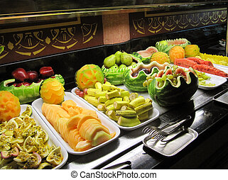 Fruit salad bar - Decorative arrangement of fruits in a...