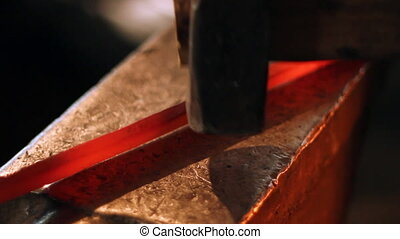 Hammer and anvil 3 - Blacksmith work. Hammer blows on a hot...