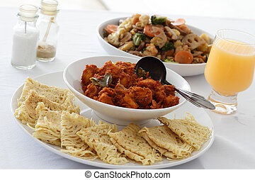 Rendang Chicken - A dish of Rendang chicken with Roti Jala,...