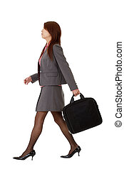 Business woman walking, full length pose isolated on white...