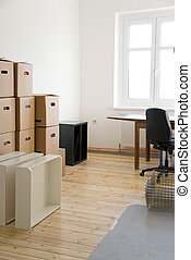 house moving - moving boxes in a flat with parquet floor
