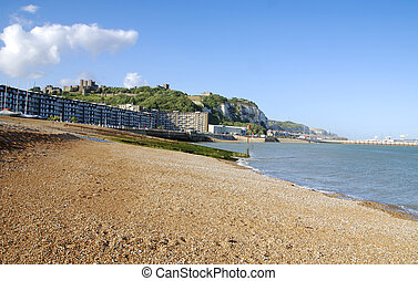 Beach in Dover with a view at the Castle and industrial pier