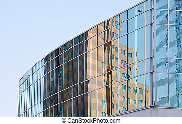 Yellow Hotel Reflected in Blue Office Windows