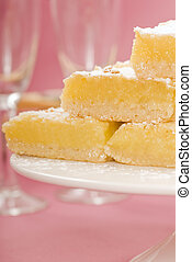 Lemon squares on a white cake stand - Delicious freshly...