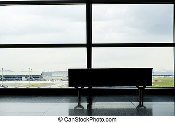 travelers in transit - empty bench of the observation deck...