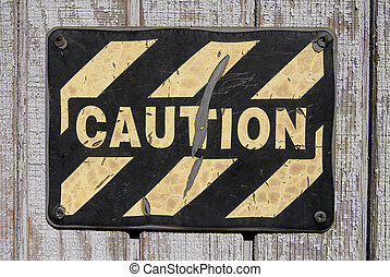 Caution Sign - Old worn caution sign