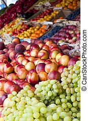 Fruit stand with grapes in market - Fruit stand in market...