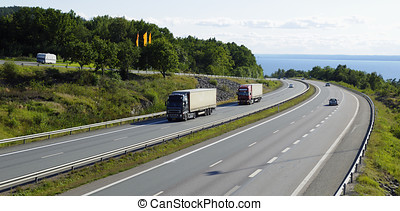 highway and heavy transport - scenic highway with sea in...