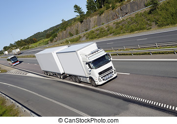 truck transport on highway - clean white truck driving on...