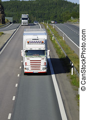 truck driving on road - white truck, frontal view, driving...