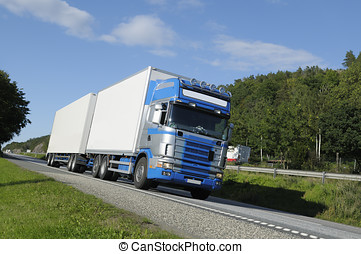 trucking on scenic highway - large delivery truck driving on...