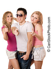 two smiling sexy women and handsome young man - Portrait of...