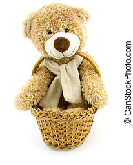 Toy bear in a small basket - Smiling toy bear is sitting in...