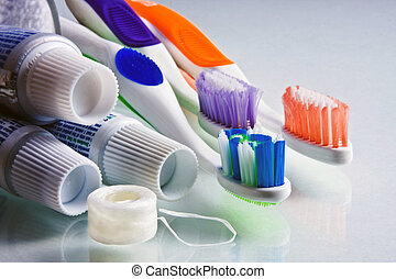 Toothpaste, Toothbrushes and Floss - Toothpaste tubes with...