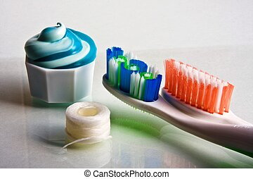 Swirled Toothpaste & Toothbrushes - Toothpaste squeezed from...