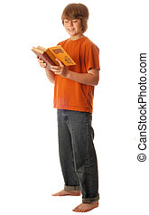 attractive young teenage boy reading a book isolated on white background