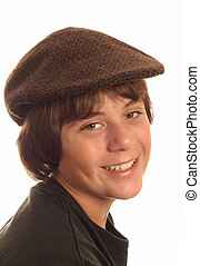 attractive thirteen year old boy wearing a flat cap isolated...