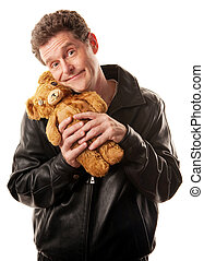 Cool Dude with Toy - Man in leather jacket clasps teddy bear