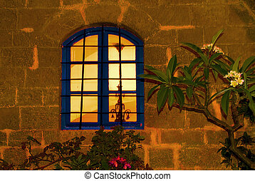 Mistery window - A window glowing in an ancient city night.