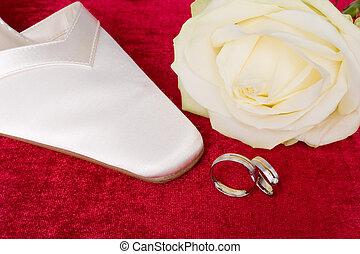wedding ring and wedding shoe