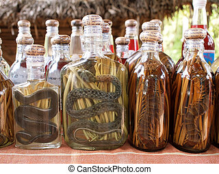 liquor with snakes and centipedes - bottles of liquor with...