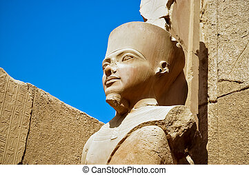 The statue of Amun Re in Luxor - A statue of Amun Re in the...