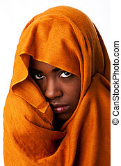 Mysterious female face in ocher head wrap - Beautiful...