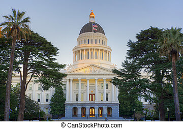 Sunligth tipped Capitol Building - Sunset shines on top dome...
