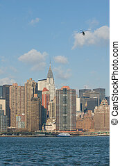 panorama of manhattan with flying helicopter