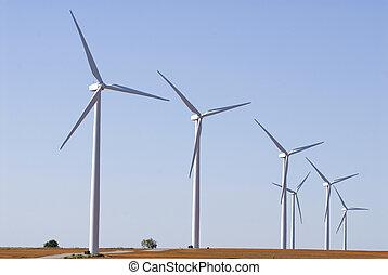 Windfarm on farm land - Modern windfarm located on farmland...