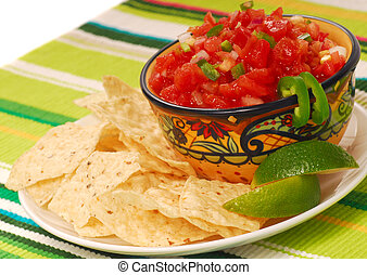 Tortilla chips with salsa and lime - Freshly made tortilla...
