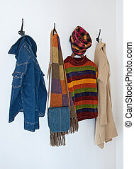 Colorful clothing on coat hooks - Colorful clothing and bag...