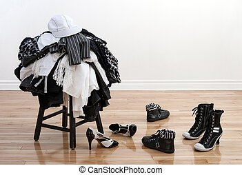 Heap of clothing on a stool and disordered shoes - Heap of...